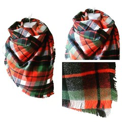 sleeve(0.0), orange(1.0), pattern(1.0), textile(1.0), wool(1.0), clothing(1.0), outerwear(1.0), scarf(1.0), design(1.0), tartan(1.0), plaid(1.0),