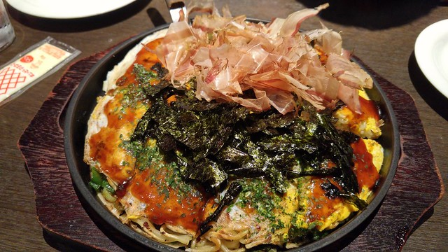 Okonomiyaki Negiyaki soba (Hiroshima style): green onion base with fried squid, mochi, sliced pork, egg, and soba noodles