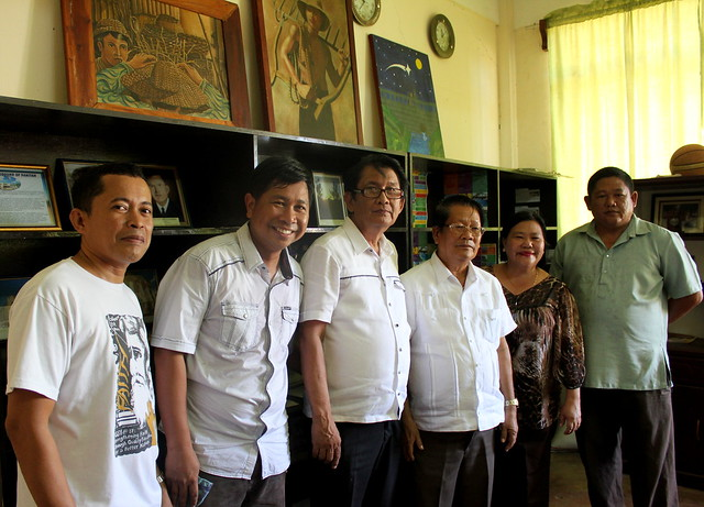 Panitan High School social sciences teacher Micle S. Haguisan (center) poses with staff in the school's history 'museum', Mayor Derramas, school principal Maria Lea, located in the newly-rehabilitated Panitan Civic Center