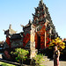 Bali 2015, Pura Puseh Temple Batuan, Jody under blues skies with tempe weru WM