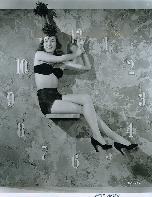 Woman on a clock wall