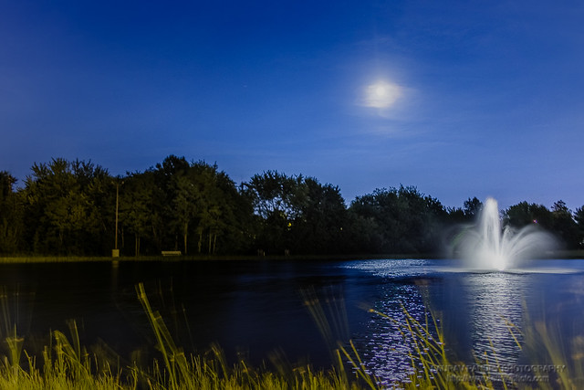 Full moon and water fountain