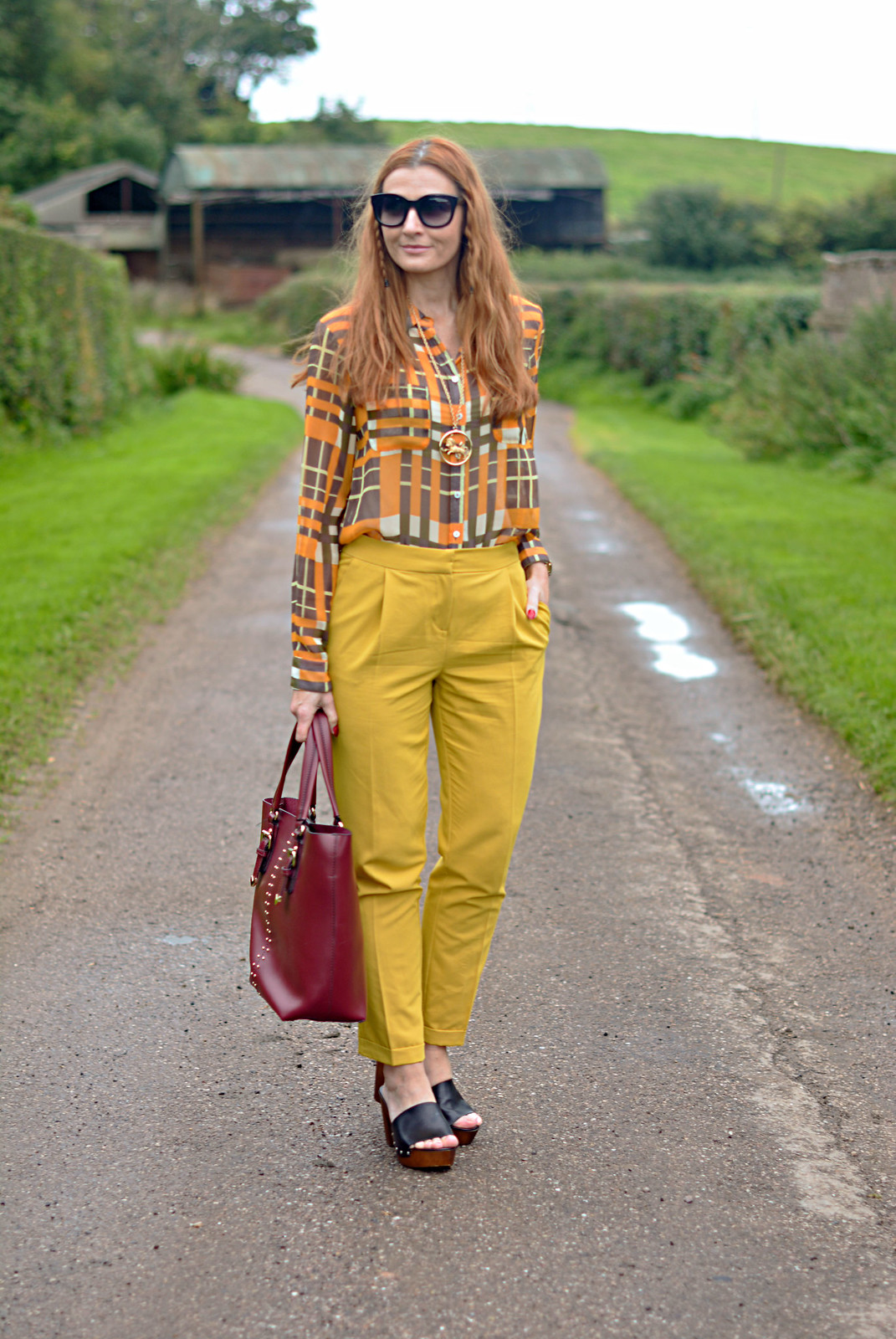 Autumnal style | Sheer plaid shirt, mustard trousers, deep red bucket bag