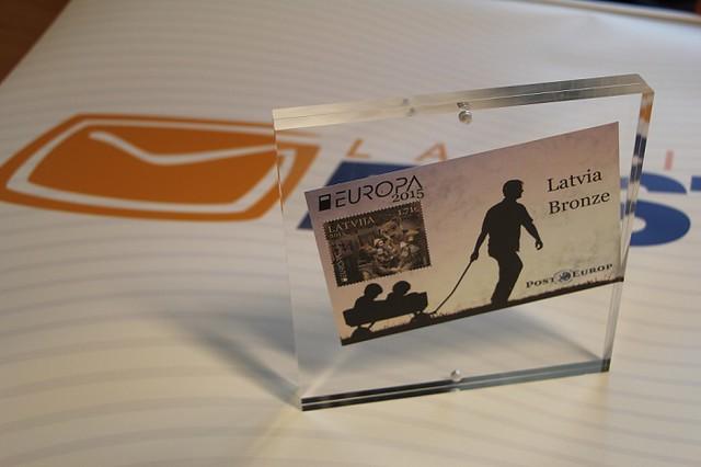 """Latvijas Pasta pastmarkas """"Senās rotaļlietas"""" godalgotas Eiropas valstu pasta asociācijas konkursā"""