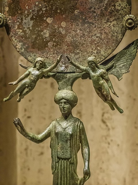 Closeup of Greek mirror depicting Aphrodite (?) with flanking Erotes (cupids) said to be from an Etruscan tomb 465-450 BCE Bronze