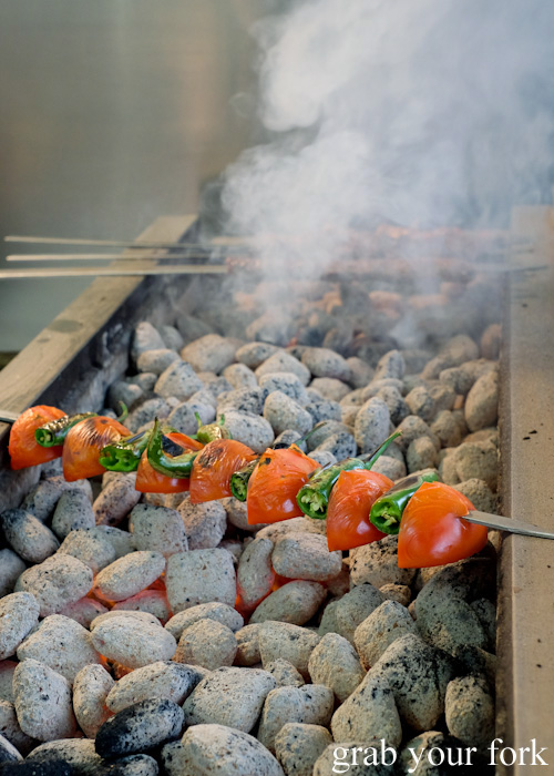 Grilled and blistered tomato and green chilli shish kebabs at New Star Kebabs, Auburn