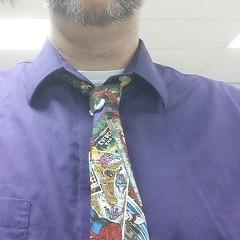 sleeve(0.0), formal wear(0.0), pattern(1.0), neck(1.0), textile(1.0), clothing(1.0), purple(1.0), violet(1.0), collar(1.0), dress shirt(1.0), cobalt blue(1.0), outerwear(1.0), necktie(1.0),