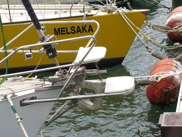Closer close up to adjoining boat, with a large metal protrusion that looks like a diaper pin