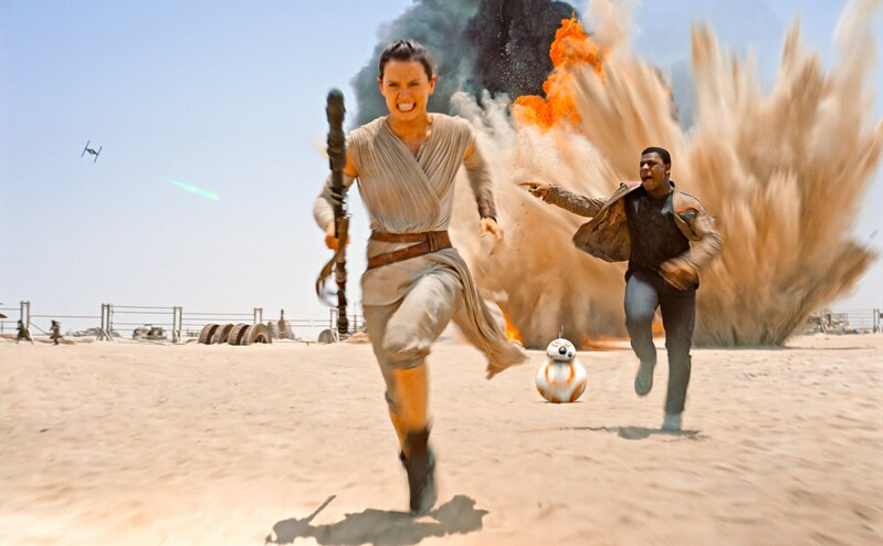 Daisy Ridley and John Boyega run for cover in the eminently satisfying STAR WARS: EPISODE VII - THE FORCE AWAKENS.