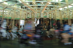 Whizzing by on the Looff Carousel