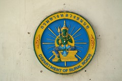 Sign of the Department of Rural Roads on a pillar at Saphan Taksin pier by the Chao Phraya river in Bangkok, Thailand