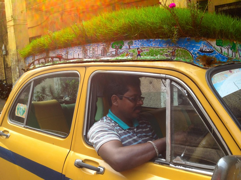 Dhananjoy Chakraborty aka Bapi at driver seat - Bapi Green Taxi in Kolkata, India