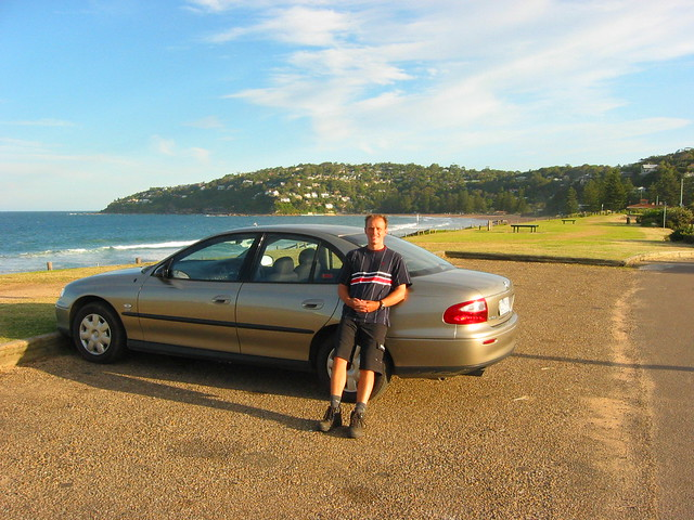 Me restong on our rental car on Palm Beach