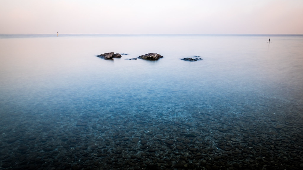 Rocks in Garda lake, Sirmione, Italy picture
