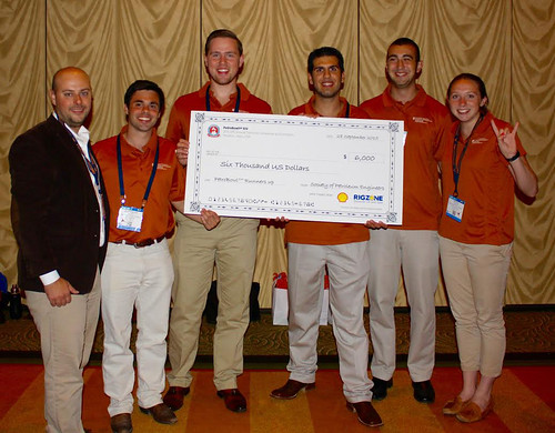 UT PGE students and Dr. Matt Balhoff receive the check for their second place finish in the PetroBowl Championship