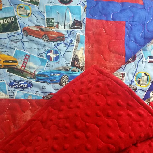 Ms. Carol's mustang quilt with minkee back got a wraparound binding last night. Another Christmas present done.