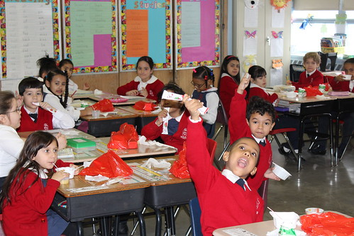 Students eating breakfast in classroom