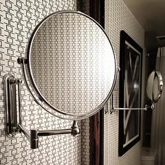 Wallpaper reflections. #bathroommirror #kimpton