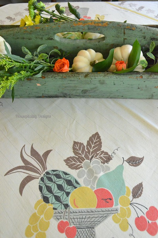 Fall Centerpiece with Antique Tool Caddy and Vintage Tablecloth - Housepitality Designs