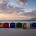 Muizenberg Beach Huts Sunrise Walker by Panorama Paul