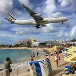Maho Beach, St. Maarten just ahead of the Princess Juliana Airport runway. From tiny DHL mail jets to huge 747s, a continual show of dramatic landings runs right over the heads of beach goers. And this isn't even as insanely low as the planes go. Never ha