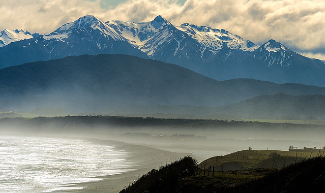 View of storm blowing across Te Waewae Bay looking towards the Southern Alps, from near Pahia.