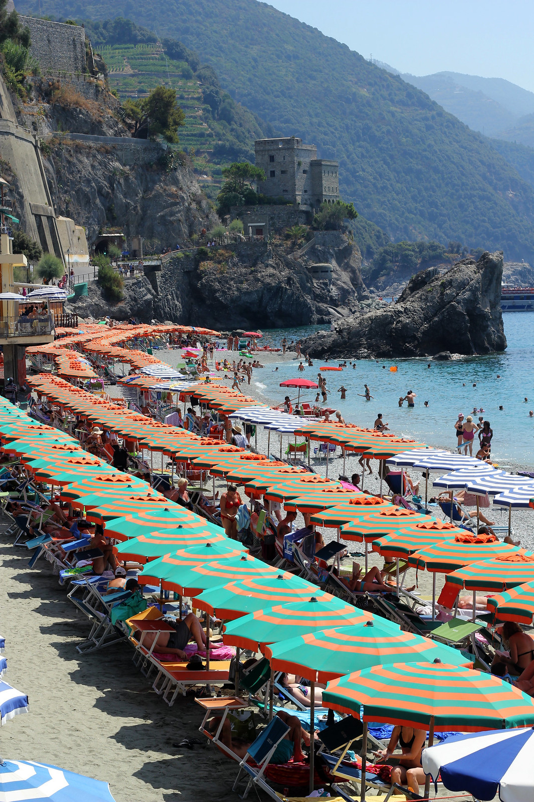 Monterosso Cinque Terre colorful striped beach umbrellas