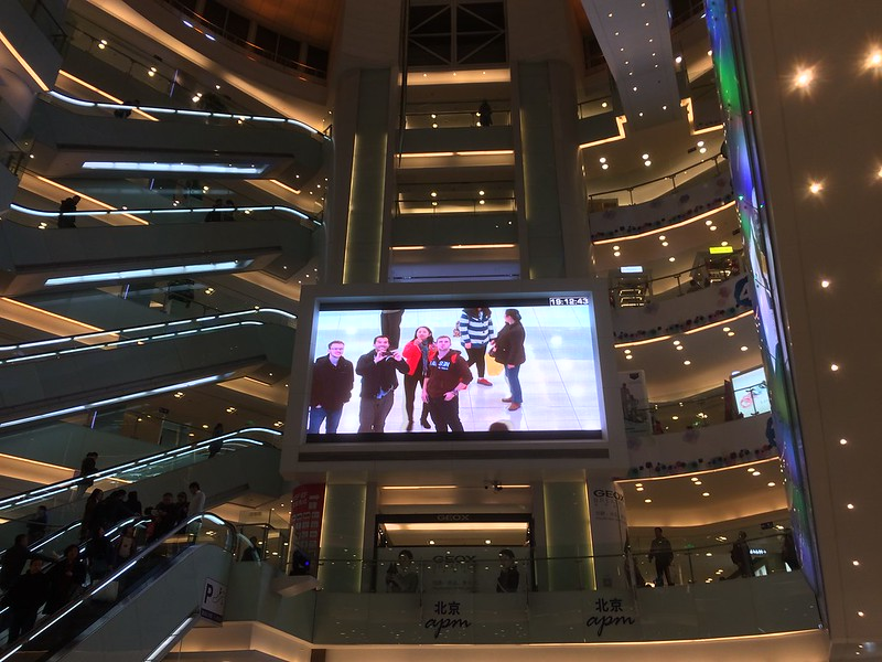 Seeing ourselves on the big screen at Sun Dong An Plaza.