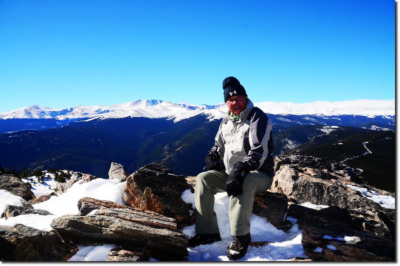 Me on the summit of Chief Mountain, in the background is Mount Evans Massif 1