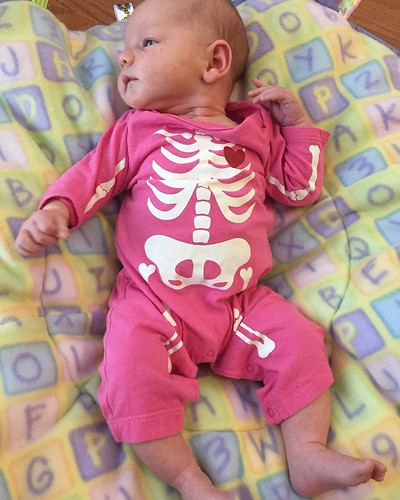 Don't be fooled by the skin and bones outfit -- this chunk is in the 88th percentile for height and weight! #onemonthold