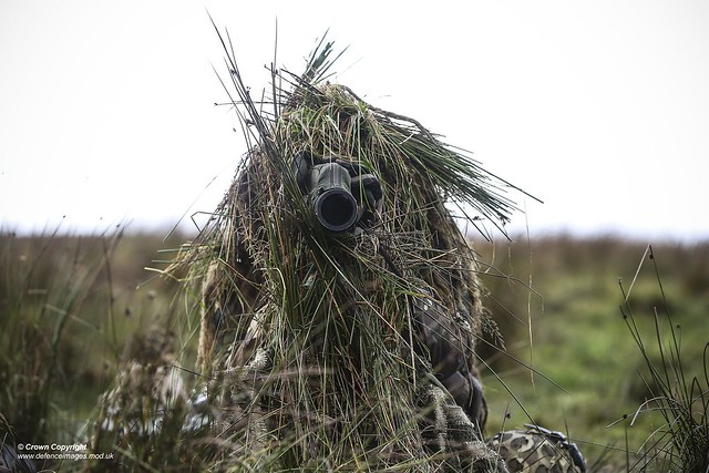 Pictured is a member of 34 Squadron, The Royal Air Force Regiment using a snotting scope during a Live Firing Tactical Training at the Otterburn Training Area.
