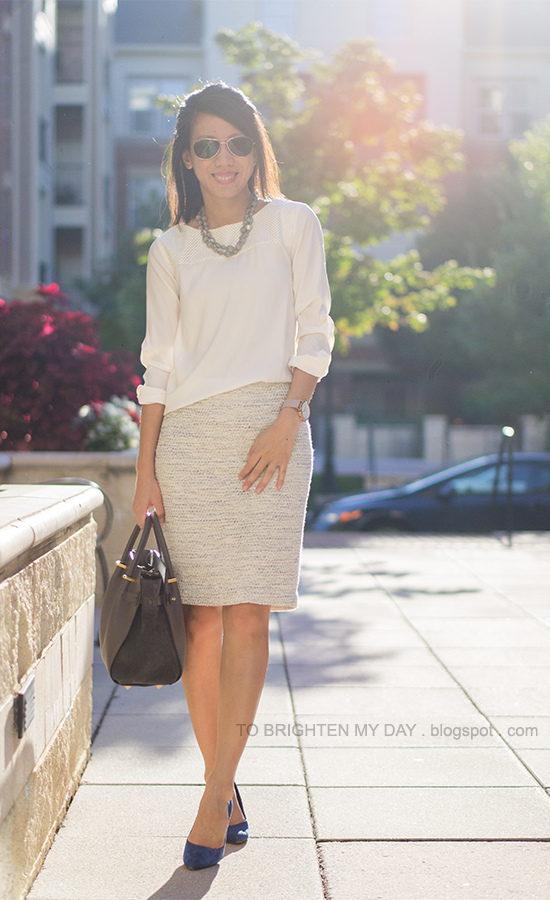 gray silk wrapped pearl necklace, white faux leather top, tweed skirt, oversized watch, blue suede pumps