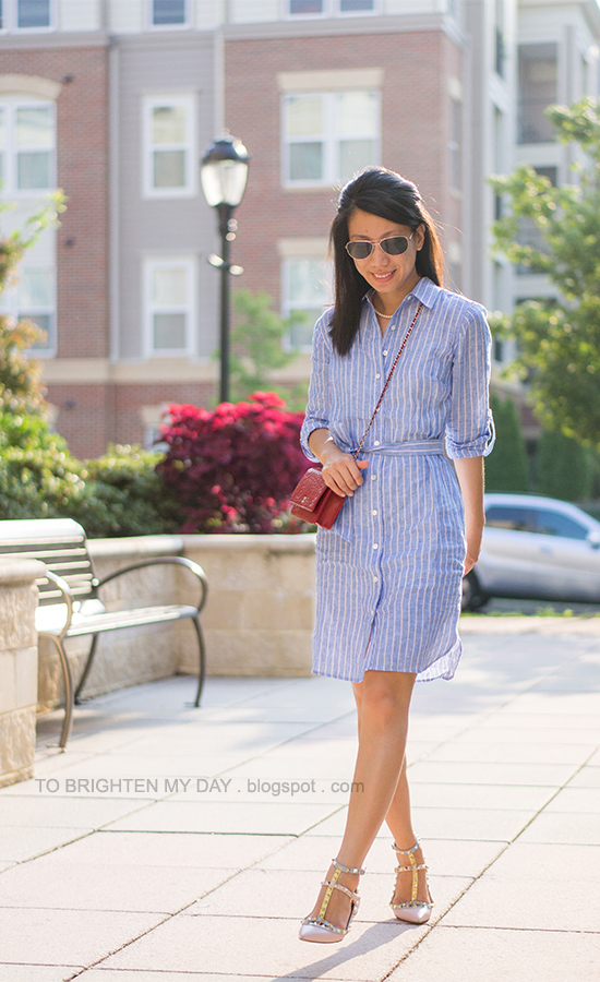 pink and blue striped dress, red crossbody bag, pastel watercolor stud flats