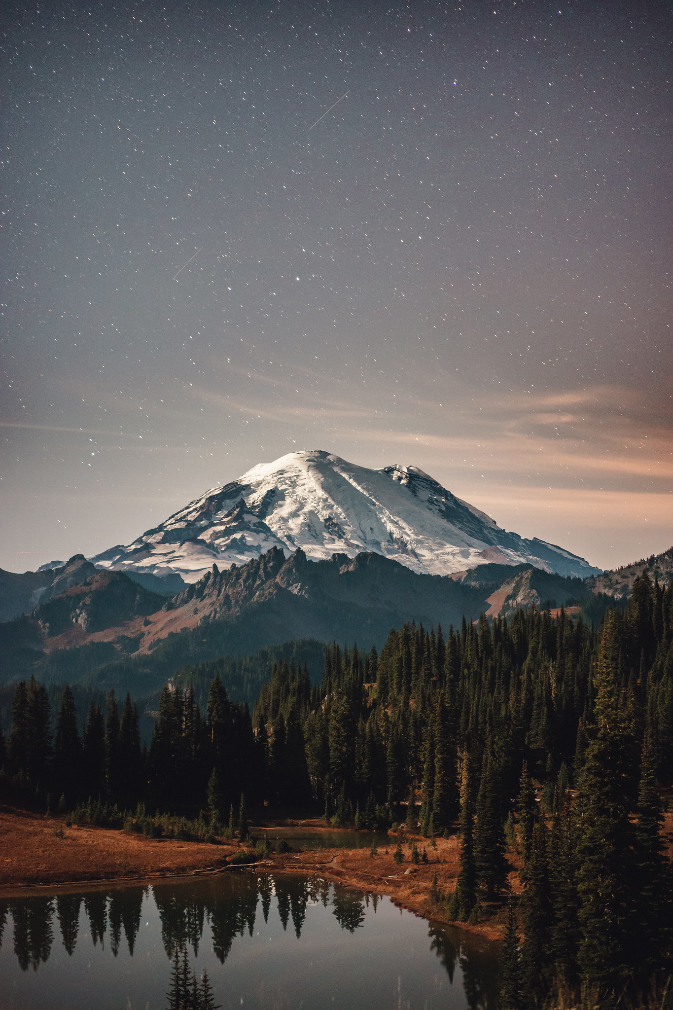 Mount Rainier under a starry sky [1365×2048] Photographed by Bryan Buchanan