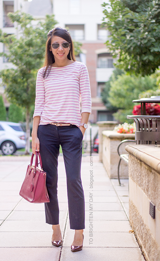 pink striped top, glitter belt, navy pants, oversized watch, burgundy pumps