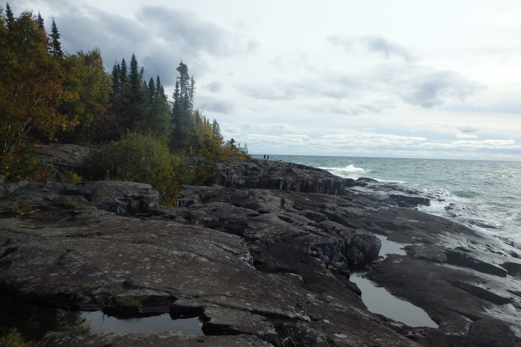 rocky shoreline with trees turning colors