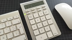 cash(0.0), office equipment(1.0), font(1.0), numeric keypad(1.0), calculator(1.0), computer keyboard(1.0),