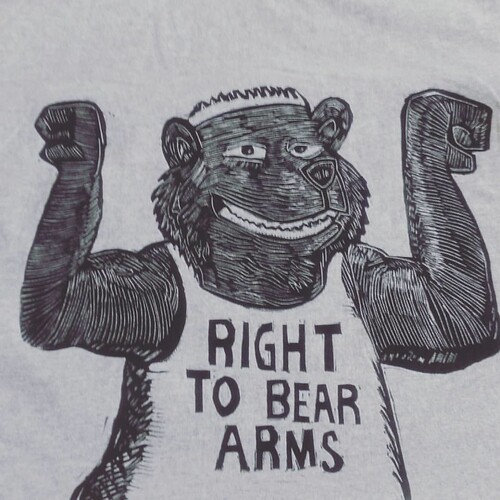 You have the right to bear arms! This is a right for all bears and humans.  Gun show all day. . . . . .  #linocut #printmaking #gunshow #sunsoutgunsout #righttobeararms #dadjokes #prints #tshirts #handmade #etchingpress #bears #fitness #tanktops #puns #be