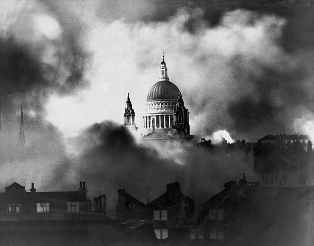 St Paul's dome seen from the smoke of fires in surrounding streets, by Herbert Mason