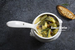Vegetable soup in white bowl on a dark background…