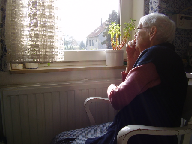 Elderly woman + her view