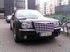 automobile(1.0), automotive exterior(1.0), executive car(1.0), vehicle(1.0), chrysler 300(1.0), chrysler(1.0), bumper(1.0), land vehicle(1.0), luxury vehicle(1.0),