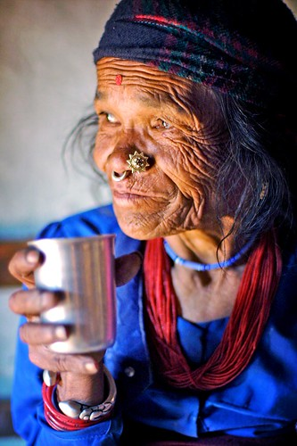 old tamang woman drinking tea