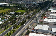 metropolitan area, town, highway, junction, bird's-eye view, transport, suburb, road, public transport, urban area, controlled-access highway, residential area, overpass, aerial photography, downtown, neighbourhood, infrastructure,