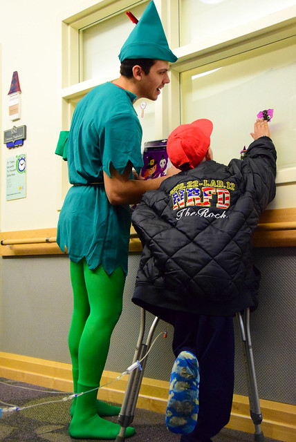 Firefighter Ryan Pascuzzi decorating with a child patient