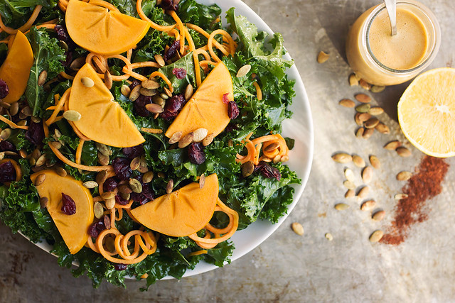 Massaged Kale Salad with Sweet Potato Noodles, Persimmon and a Smoky Orange Vinaigrette