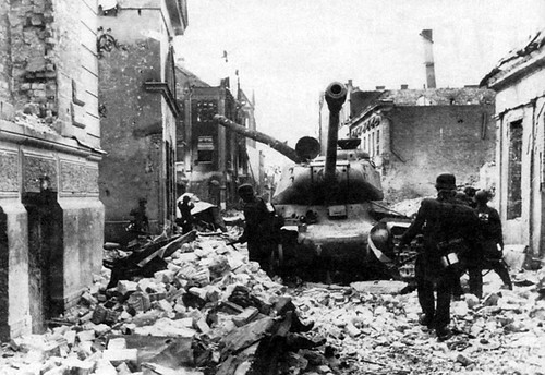 German soldiers & Soviet IS-2 tank of the 2-3-20th guards heavy tank Regiment during the fighting in Jelgava