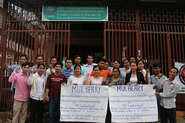 Cambodian Labour Confederation members hold signs in Khmer, Turkish, and English in support of Mulberry workers in Turkey