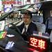 Taxi driver - Tokyo, Japan by Maciej Dakowicz