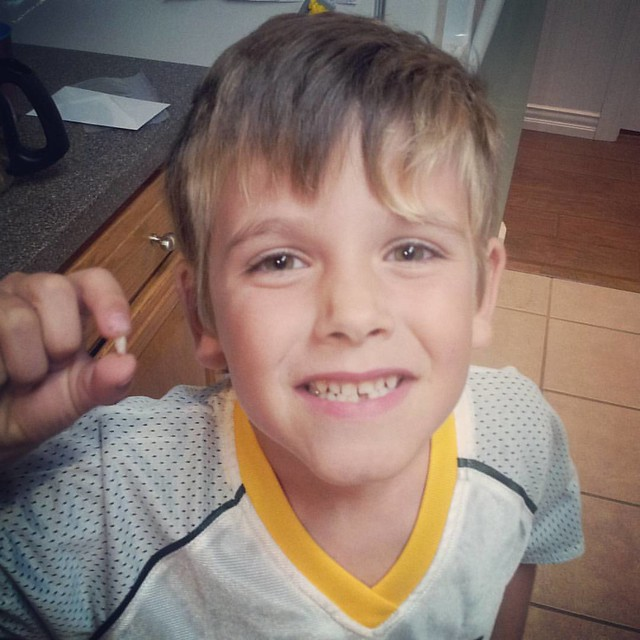 Tooth #2 fell out during football practice! So sad I've missed both of his teeth falling out so far. Can't believe how big he's getting! #mboys2015